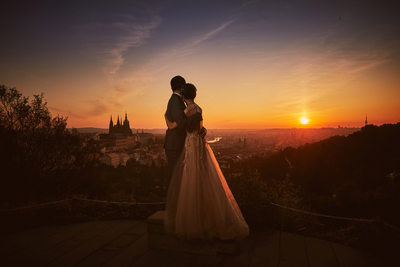 elegant couple watching the sunrise