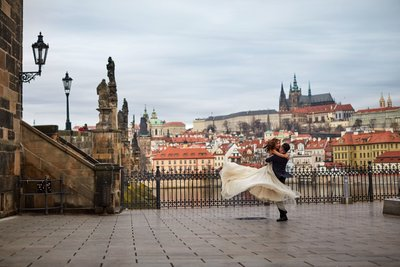 spinning his bride near the Charles Bridge