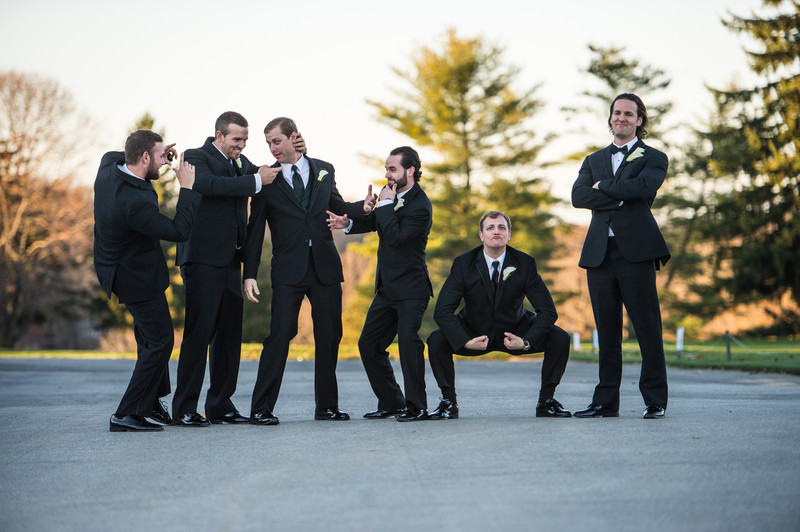 Groom and Groomsmen Having Fun At A Penn Oaks Wedding