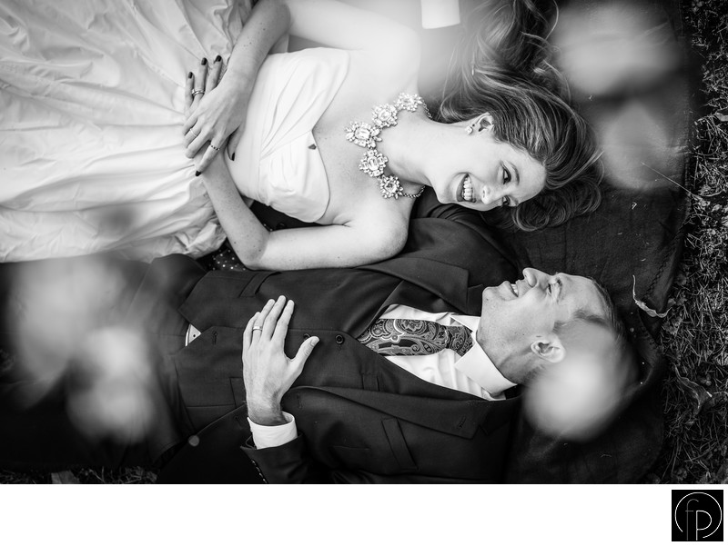 Bride and Groom Lying On The Ground For Their Portrait