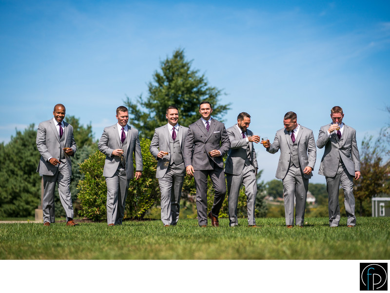 Groom and Groomsmen having fun during the wedding