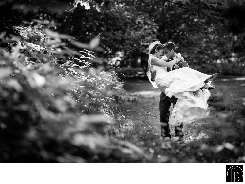 Groom Carrying The Bride At Their Old Mill Wedding