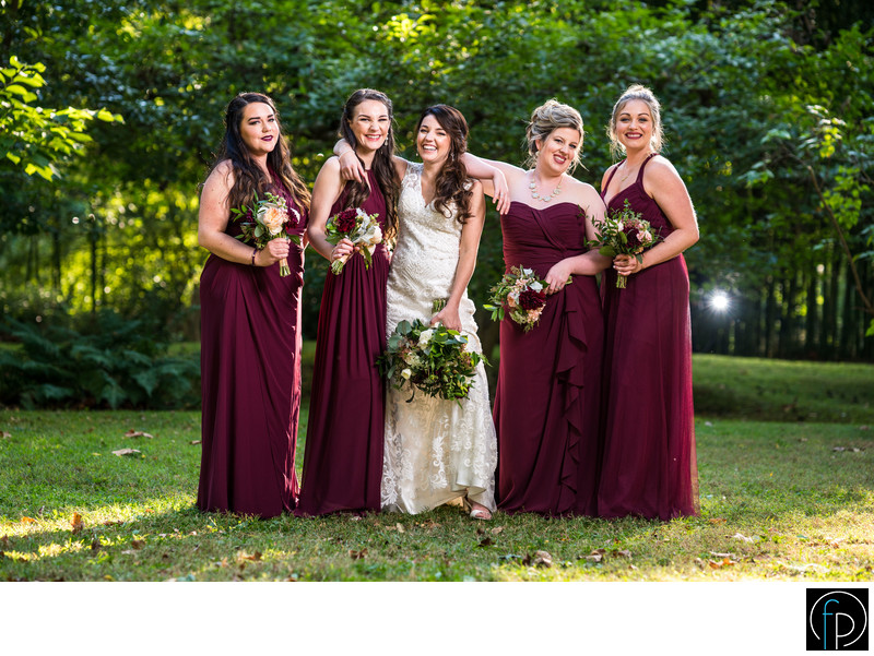 Bridesmaids Having Fun At An Old Mill Wedding