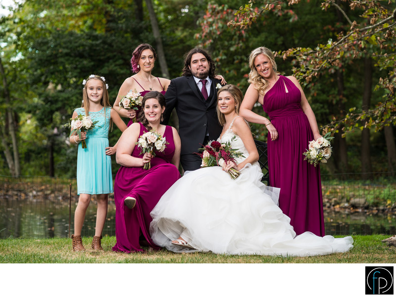 Bridal party portrait near the pond at Pomme in Radnor