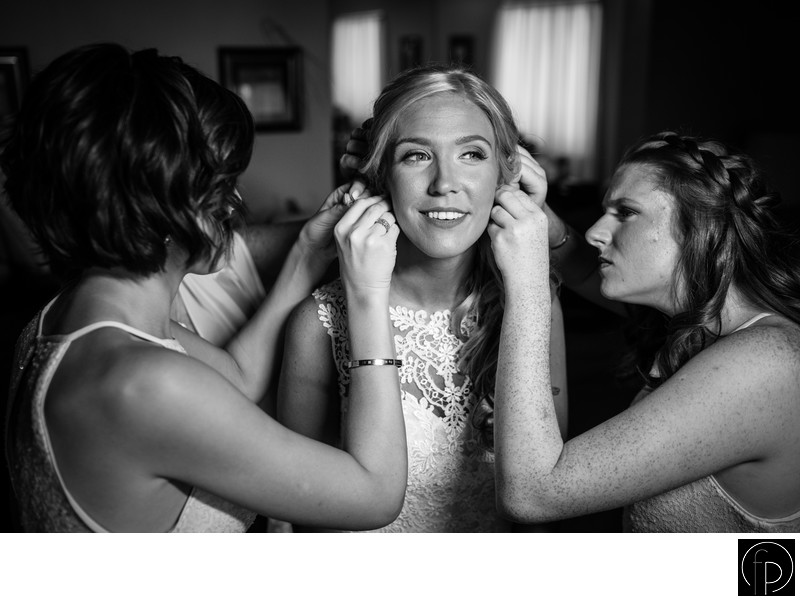 Bridesmaids Helping The Bride Get Ready