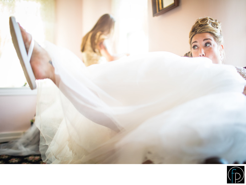 Bride Having Fun in Springton Manor Farm Bridal Suite