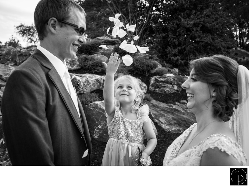 Flower Girl Having Fun With Bride and Groom