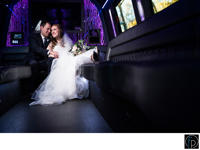 Portrait Inside The Limo Before Their Wedding Reception