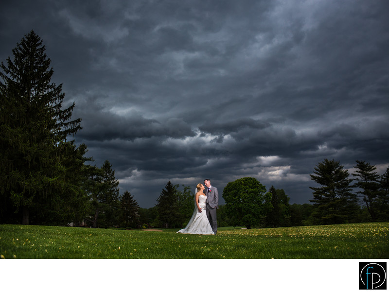 Bride and Groom Before A Storm At Penn Oaks Wedding