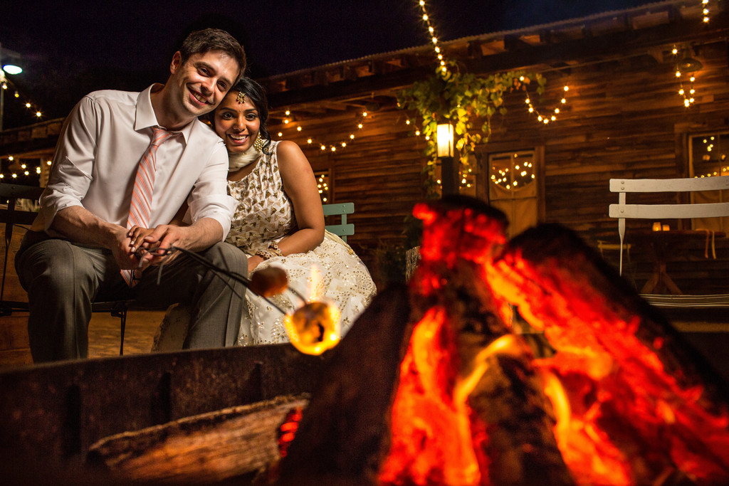 Bride and Groom At A Fire Pit At Terrain in Glen Mills