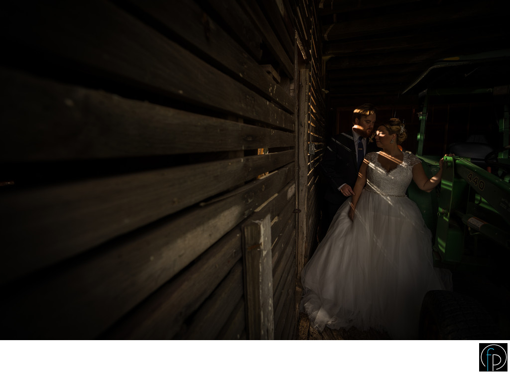 Bride and Groom Inside Barn at Springton Manor Farm