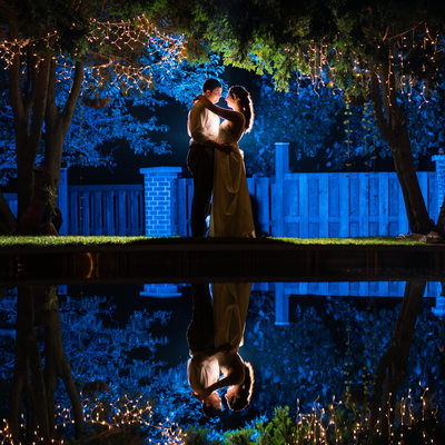 Night Portrait of Bride and Groom with Reflection