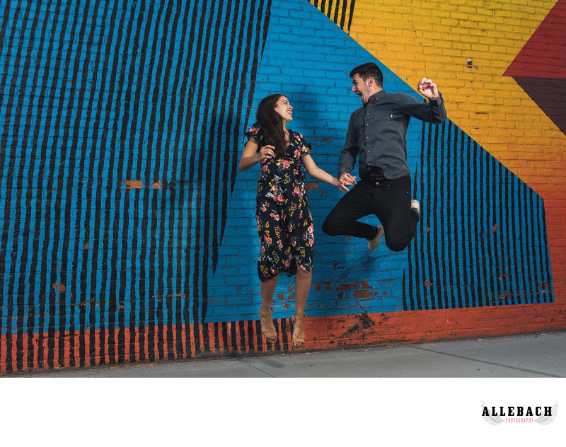 Couple Jumping in DUMBO Engagement photo Session