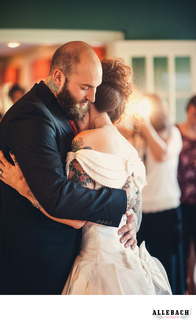 Tattooed Bride and Groom Dancing at Wedding
