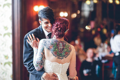 Tattooed Bride and Groom Dancing