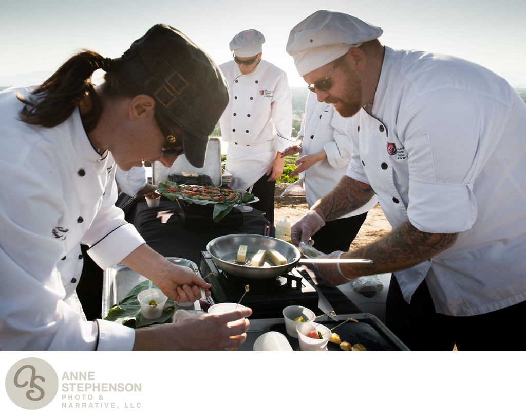 Chefs prepare dinner outdoors at biodynamic farm