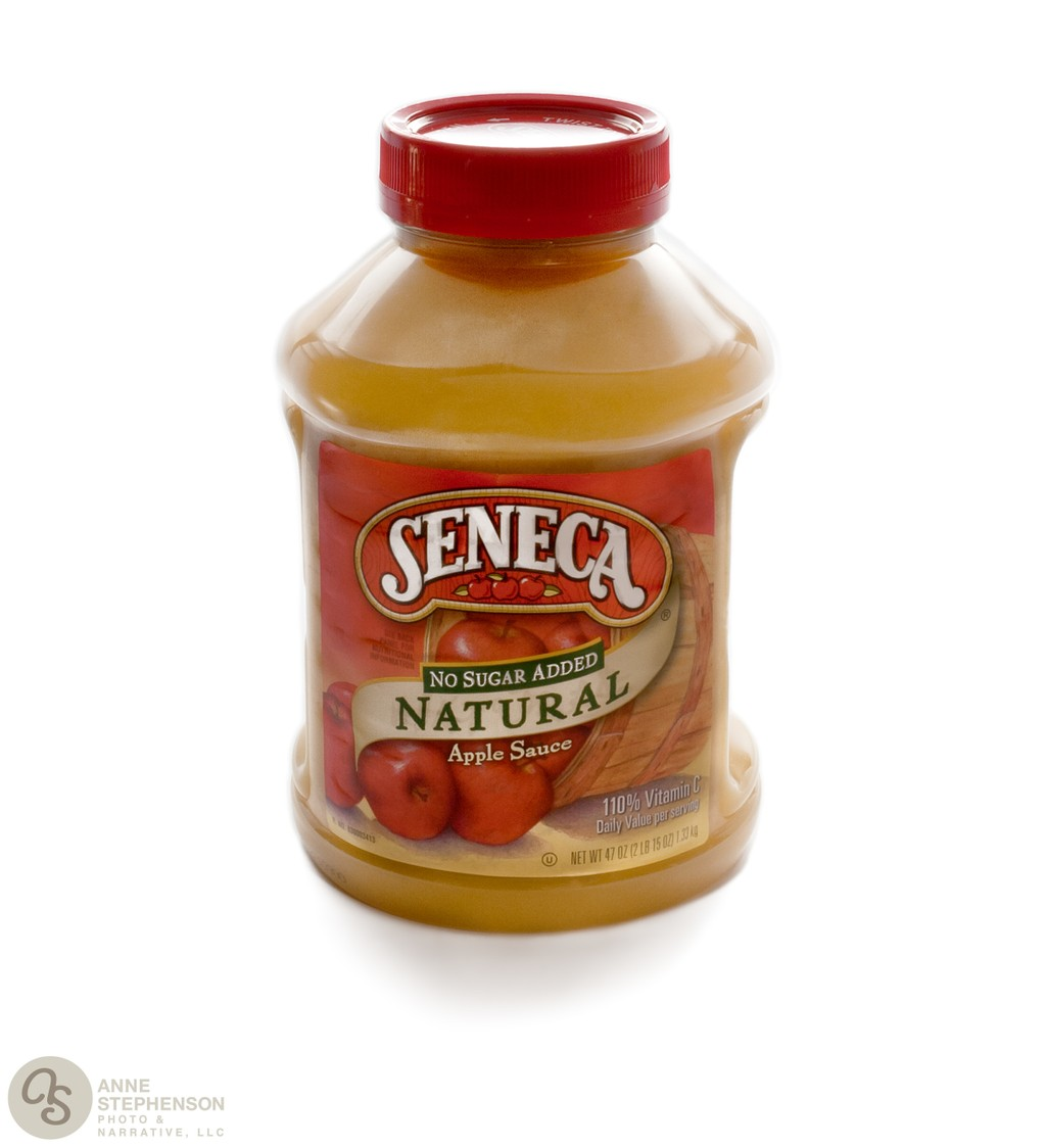 Jar of Seneca brand apple sauce on a white background