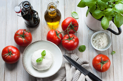 Prepping Tomato Caprese Salad with Vegan Cheese