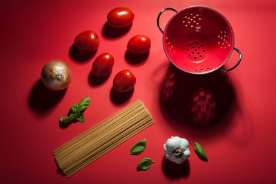 Scene showing ingredients used to make pasta and sauce
