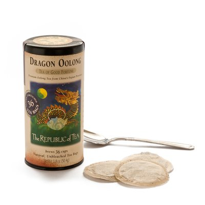 Dragon OOlong Tea tin and bags on a white background