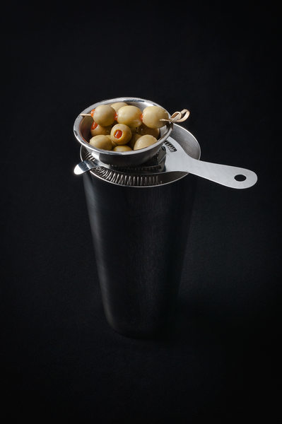 Cocktail Shaker with Green Olives on Top