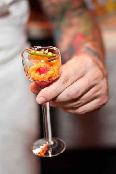 Artful chef with colorful appetizer