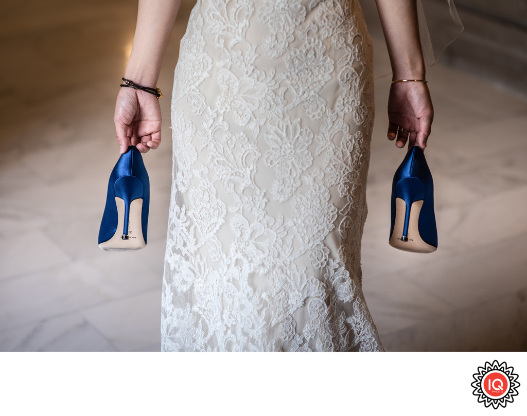 SF City Hall Bride carrying shoes