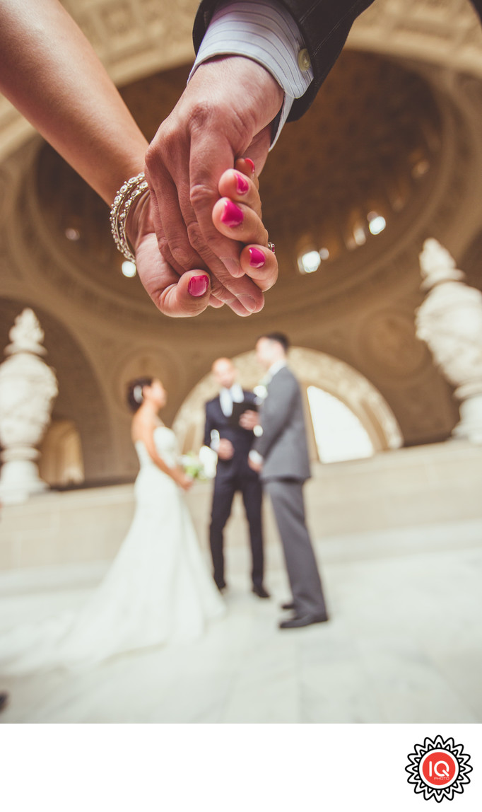 Guests holding hands at SF City Hall Wedding