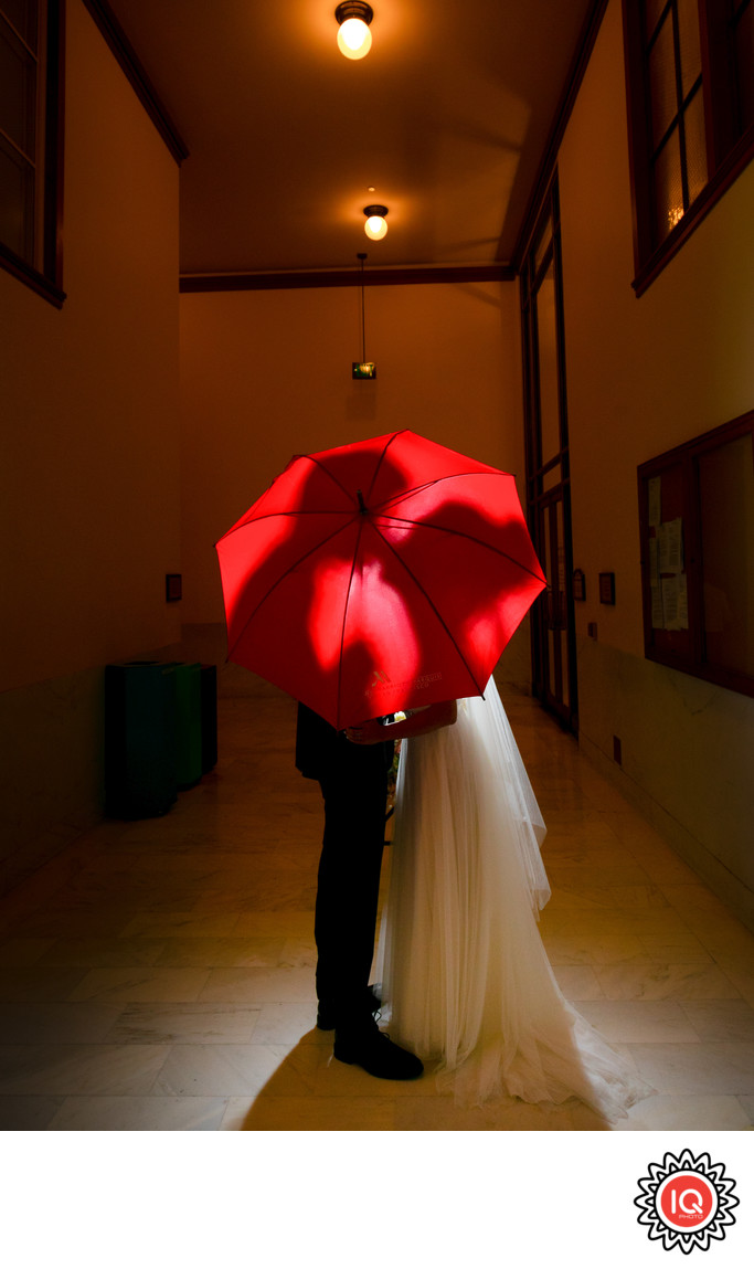 Couple under the umbrella at the county clerk office