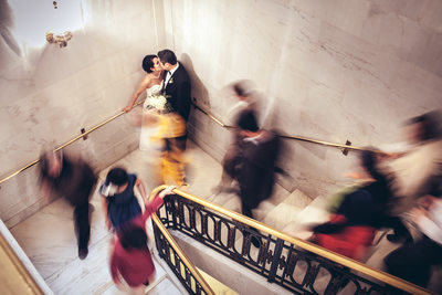 Wedding Day Kiss on the side Staircase in SF City Hall