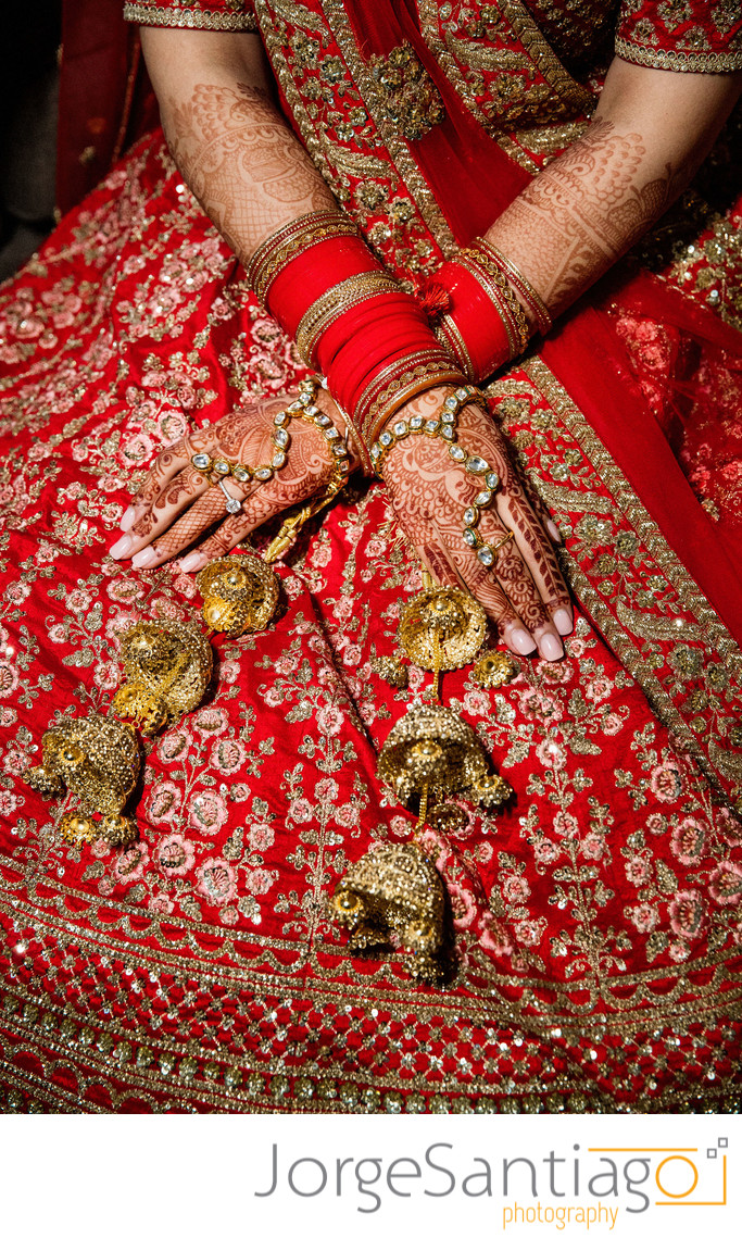 close up of south asian brides henna and bangle addorned hands
